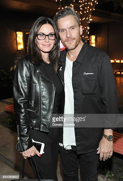Actors Courteney Cox and Balthazar Getty attend the launch of EB Florals By Eric Buterbaugh with Saks Fifth Avenue on May 25 2016 in Los Angeles...
