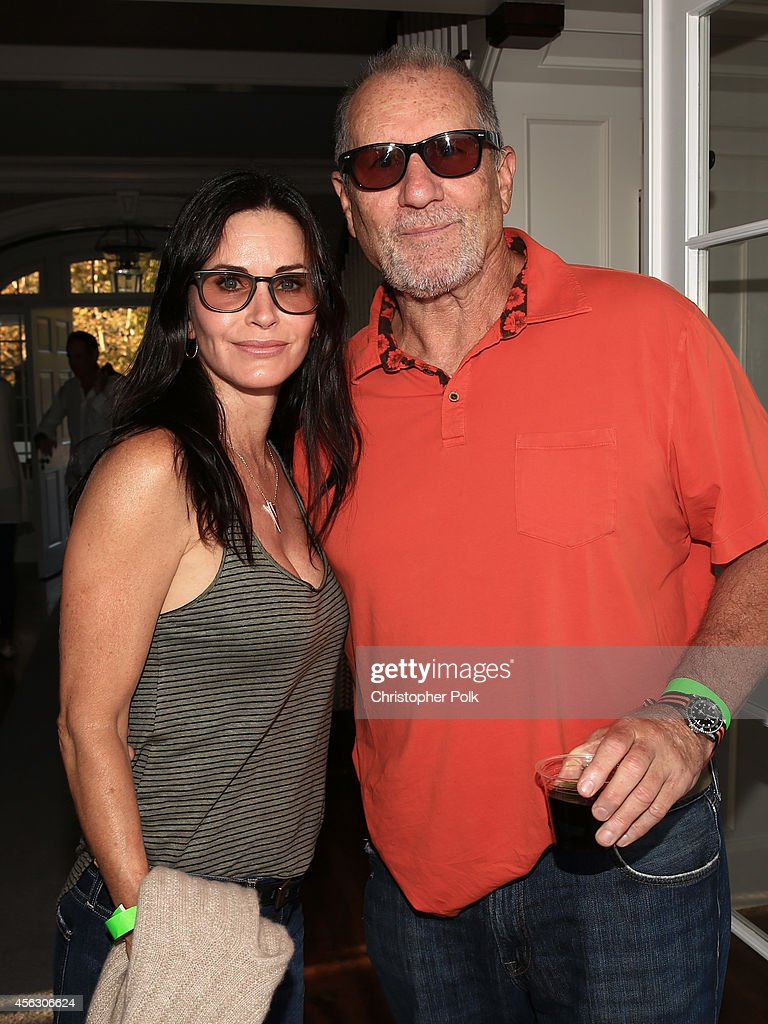 Actors Courteney Cox and Ed O'Neill attend Rock4EB, Malibu, with Jackson Browne & David Spade sponsored by Suja Juice & Sabra Hummus at Private Residence on September 28, 2014 in Malibu, California.