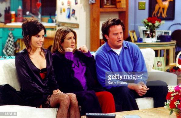 Actors Courteney Cox Arquette Jennifer Aniston and Matthew Perry are shown in a scene from the NBC series 'Friends' The series received 11 Emmy...