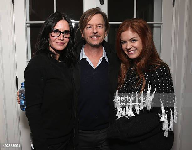 Actors Courteney Cox David Spade and Isla Fisher attend Rock4EB 2015 with Ed Sheeran and David Spade on November 15 2015 in Malibu California