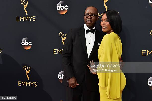 Actors Courtney B Vance and Angela Bassett attend the 68th Annual Primetime Emmy Awards at Microsoft Theater on September 18 2016 in Los Angeles...