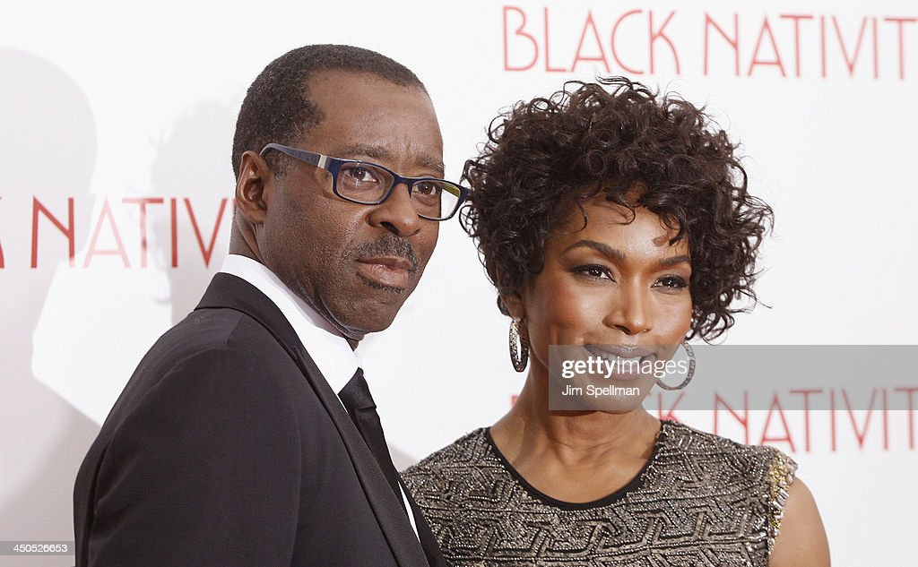 Actors Courtney B. Vance and Angela Bassett attend the 'Black Nativity' premiere at The Apollo Theater on November 18, 2013 in New York City.