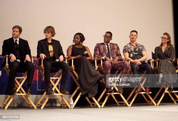Actors Crispin Glover Bruce Langley Yetide Badaki Orlando Jones Pablo Schreiber and Betty Gilpin speak on stage at the premiere of 'American Gods'...