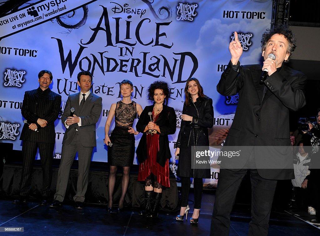 Actors Crispin Glover Michael Sheen Mia Wasikowska Helena Bonham Carter Anne Hathaway ande director Tim Burton appear onstage at Walt Disney Pictures...