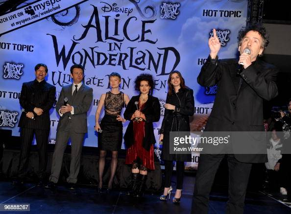 Actors Crispin Glover Michael Sheen Mia Wasikowska Helena Bonham Carter Anne Hathaway ande director Tim Burton appear onstage at Walt Disney Pictures...