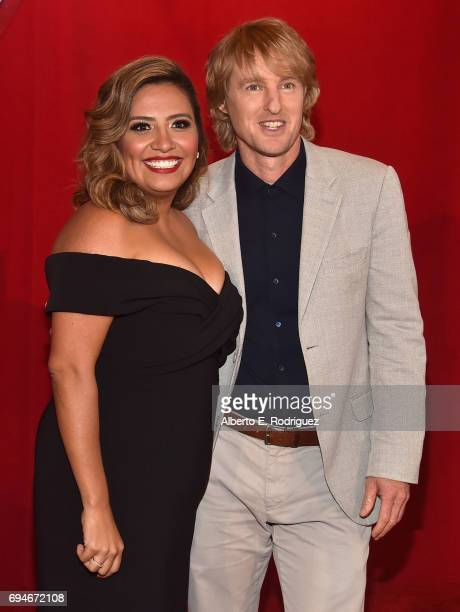 """Actors Cristela Alonzo and Owen Wilson pose at the World Premiere of Disney/Pixar's """"Cars 3' at the Anaheim Convention Center on June 10 2017 in..."""