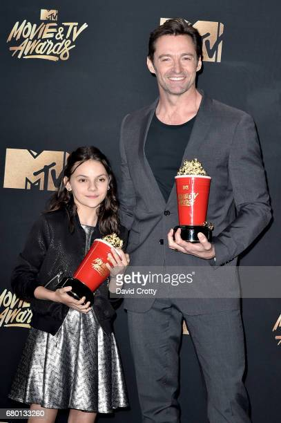 Actors Dafne Keen and Hugh Jackman winners of the Best Duo award for 'Logan' attend the 2017 MTV Movie And TV Awards at The Shrine Auditorium on May...