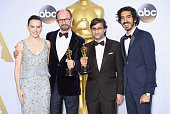 Actors Daisy Ridley and Dev Patel pose with directors James GayRees and Asif Kapadia winners of Best Documentary Feature 'Amy' in the press room...