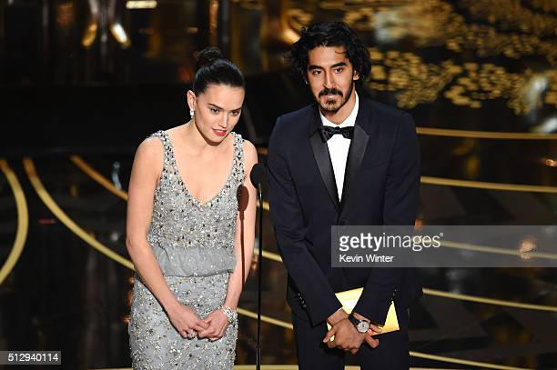 Actors Daisy Ridley and Dev Patel speak onstage during the 88th Annual Academy Awards at the Dolby Theatre on February 28 2016 in Hollywood California