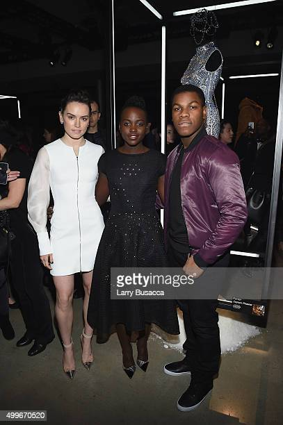 Actors Daisy Ridley John Boyega and Lupita Nyong'o pose with Parker's Star Warsinspired look for the Star Wars 'Force 4 Fashion' Event on Dec 2 at...