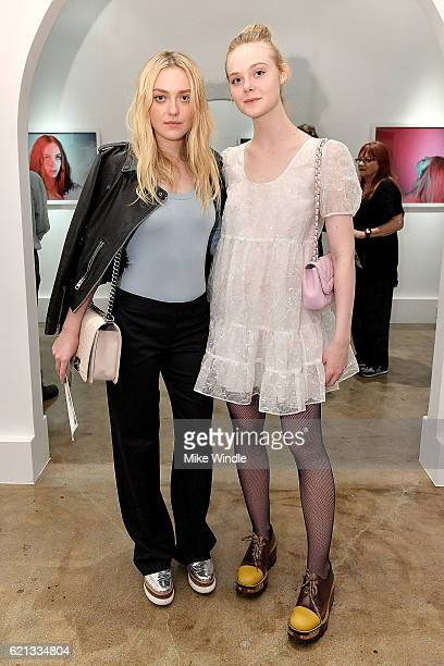Actors Dakota Fanning and Elle Fanning attend the opening of the Anton Yelchin photography exhibit at Other Gallery on November 5 2016 in Los Angeles...