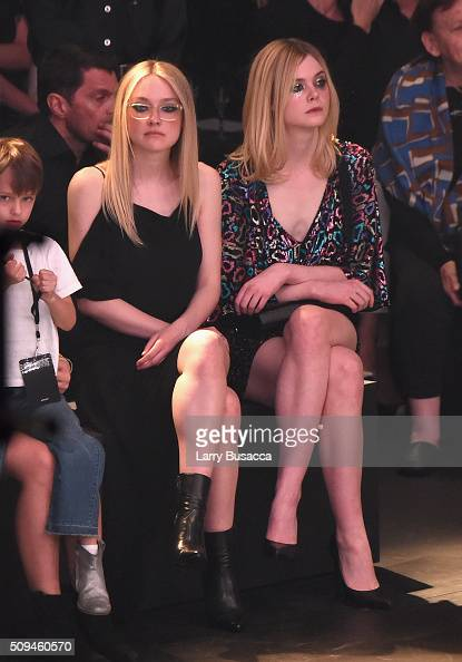 Actors Dakota Fanning and Elle Fanning in Saint Laurent by Hedi Slimane attend Saint Laurent at the Palladium on February 10 2016 in Los Angeles...