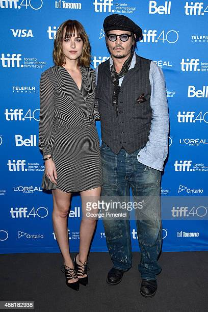 Actors Dakota Johnson and Johnny Depp attend the 'Black Mass' press conference at the 2015 Toronto International Film Festival at TIFF Bell Lightbox...