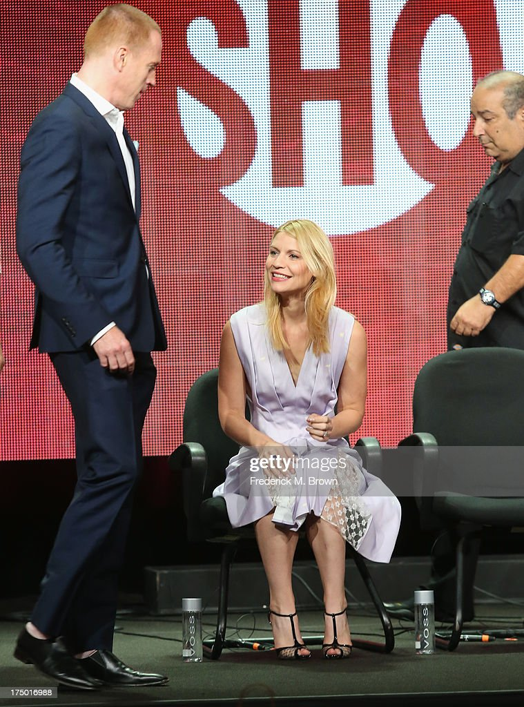 Actors Damian Lewis and Claire Danes speak onstage during the 'Homeland' panel discussion at the CBS, Showtime and The CW portion of the 2013 Summer Television Critics Association tour at the Beverly Hilton Hotel on July 29, 2013 in Beverly Hills, California.
