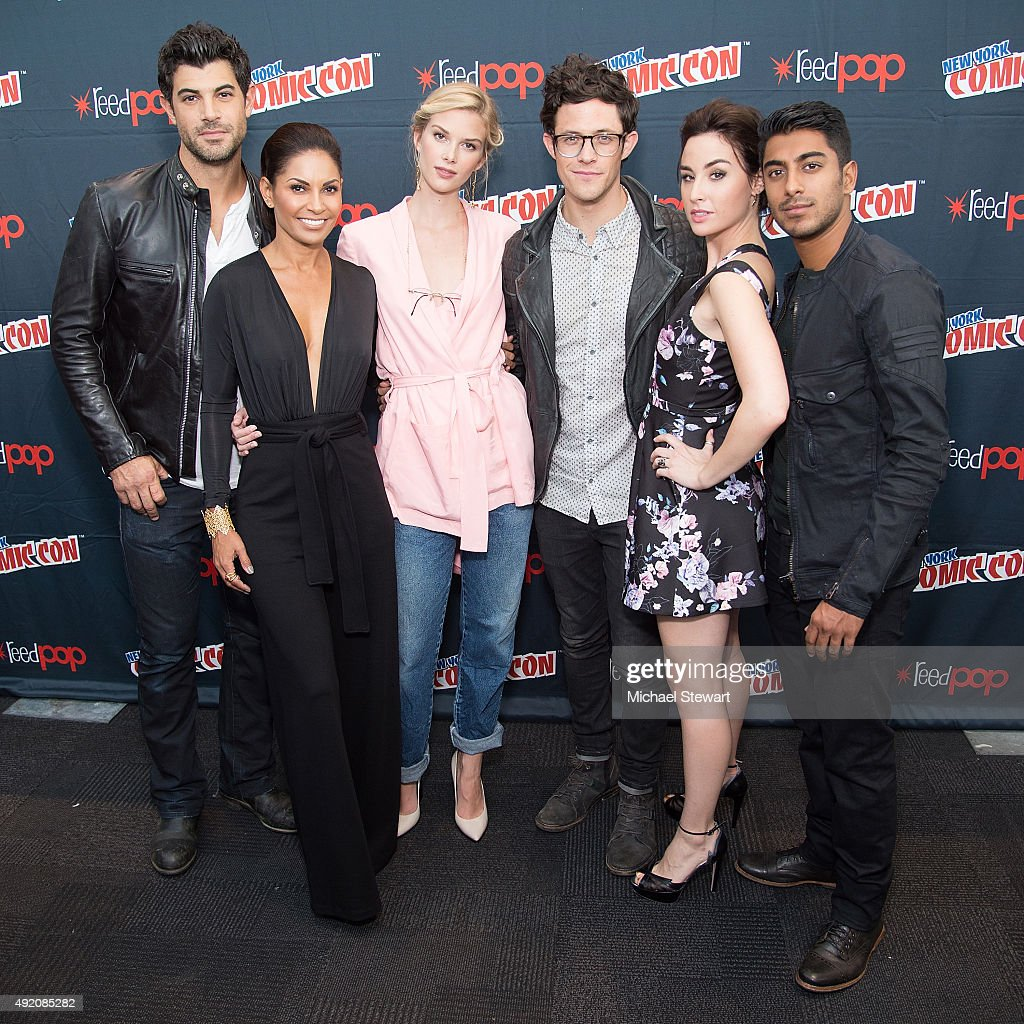 Actors Damon Dayoub, Salli Richardson-Whitfield, Emma Ishta, Kyle Harris, Allison Scagliotti and Ritesh Rajan pose in the press room for the 'Stitchers' panel during New York Comic-Con Day 2 at The Jacob K. Javits Convention Center on October 9, 2015 in New York City.
