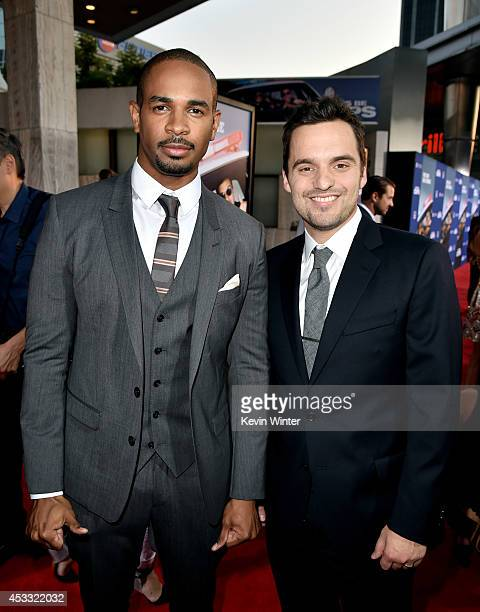 Actors Damon Wayans Jr and Jake Johnson arrive at the premiere of Twentieth Century Fox's 'Let's Be Cops' at the Cinerama Dome on August 7 2014 in...