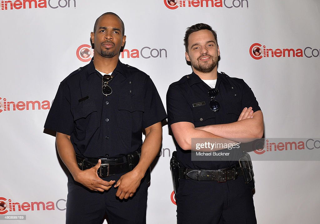 Actors <a gi-track='captionPersonalityLinkClicked' href=/galleries/search?phrase=Damon+Wayans+Jr.&family=editorial&specificpeople=748156 ng-click='$event.stopPropagation()'>Damon Wayans Jr.</a> (L) and <a gi-track='captionPersonalityLinkClicked' href=/galleries/search?phrase=Jake+Johnson+-+Actor&family=editorial&specificpeople=11543114 ng-click='$event.stopPropagation()'>Jake Johnson</a> attend 20th Century Fox's Special Presentation Highlighting Its Future Release Schedule during CinemaCon, the official convention of the National Association of Theatre Owners, at The Colosseum at Caesars Palace on March 27, 2014 in Las Vegas, Nevada.