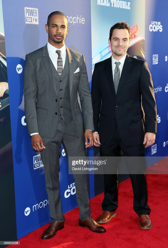 Actors <a gi-track='captionPersonalityLinkClicked' href=/galleries/search?phrase=Damon+Wayans+Jr.&family=editorial&specificpeople=748156 ng-click='$event.stopPropagation()'>Damon Wayans Jr.</a> (L) and Jake Johnson attend the premiere of Twentieth Century Fox's 'Let's Be Cops' at ArcLight Hollywood on August 7, 2014 in Hollywood, California.