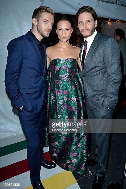 Actors Dan Stevens Alicia Vikande and Daniel Brühl arrive at 'The Fifth Estate' premiere during the 2013 Toronto International Film Festival on...
