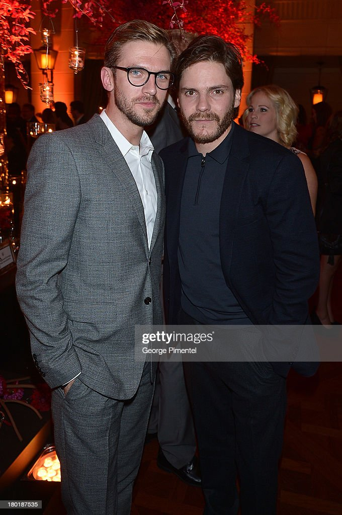 Actors <a gi-track='captionPersonalityLinkClicked' href=/galleries/search?phrase=Dan+Stevens&family=editorial&specificpeople=678756 ng-click='$event.stopPropagation()'>Dan Stevens</a> (L) and Daniel Bruhl attend InStyle and the Hollywood Foreign Press Association's Annual Toronto International Film Festival Party, hosted by Salvatore Ferragamo on Monday, September 9, 2013 held at the Windsor Arms Hotel in Toronto, Canada.
