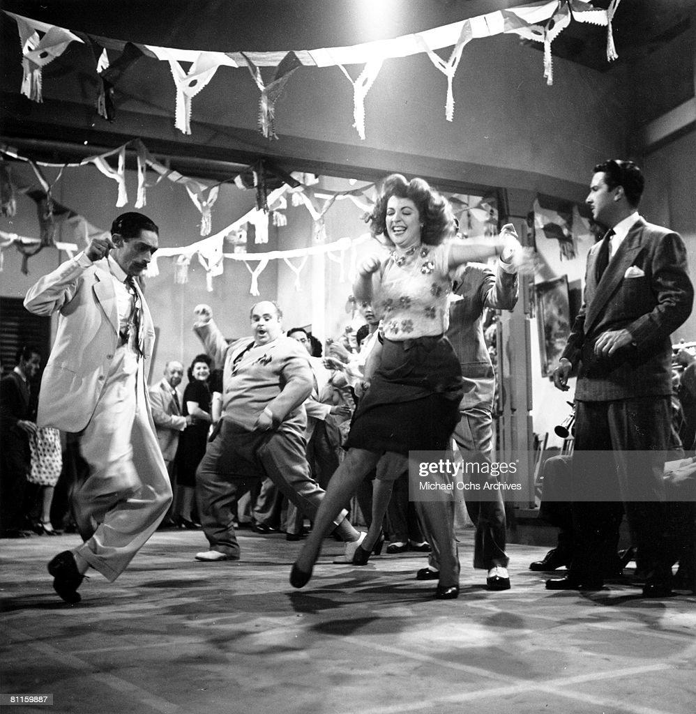 Actors dance on the set of a film production in Havana, Cuba.