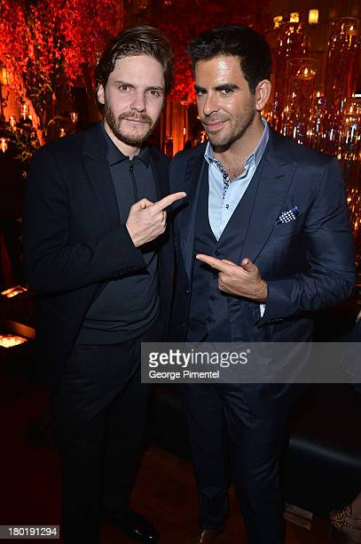 Actors Daniel Bruhl and Eli Roth attend InStyle and the Hollywood Foreign Press Association's Annual Toronto International Film Festival Party hosted...