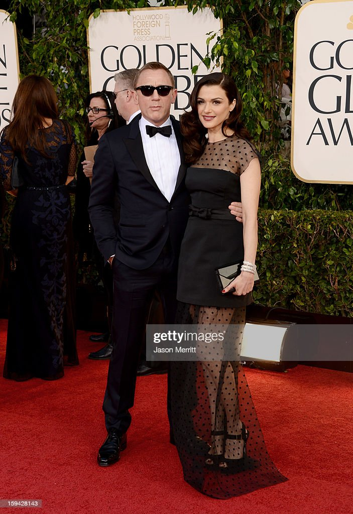 Actors Daniel Craig (L) and Rachel Weisz arrive at the 70th Annual Golden Globe Awards held at The Beverly Hilton Hotel on January 13, 2013 in Beverly Hills, California.