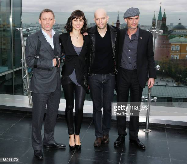 Actors Daniel Craig Olga Korylenko director Marc Forster and Anatole Taubman poses during a photocall for the new James Bond film 'Quanturm Of...