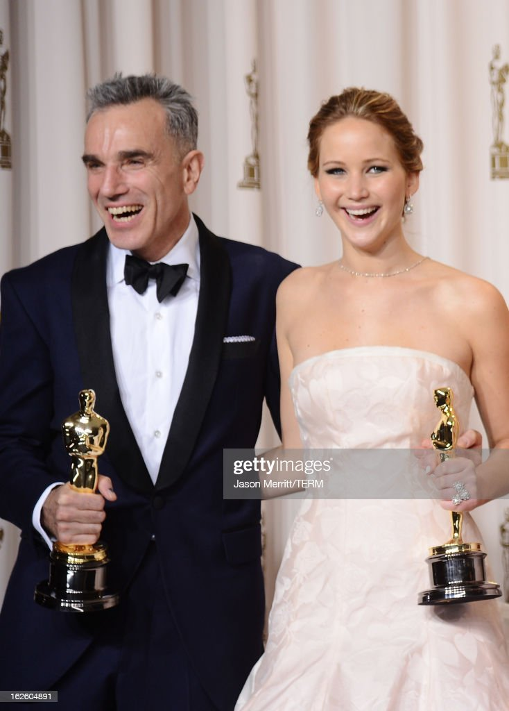 Actors Daniel Day-Lewis, winner of the Best Actor award for 'Lincoln,' and Jennifer Lawrence, winner of the Best Actress award for 'Silver Linings Playbook,' pose in the press room during the Oscars held at Loews Hollywood Hotel on February 24, 2013 in Hollywood, California.
