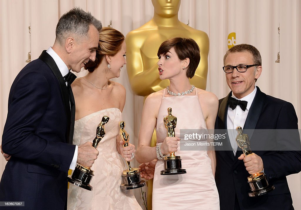 Actors Daniel Day-Lewis, winner of the Best Actor award for 'Lincoln;' Jennifer Lawrence, winner of the Best Actress award for 'Silver Linings Playbook;' Anne Hathaway, winner of the Best Supporting Actress award for 'Les Miserables;' and Christoph Waltz, winner of the Best Supporting Actor award for 'Django Unchained,' pose in the press room during the Oscars held at Loews Hollywood Hotel on February 24, 2013 in Hollywood, California.