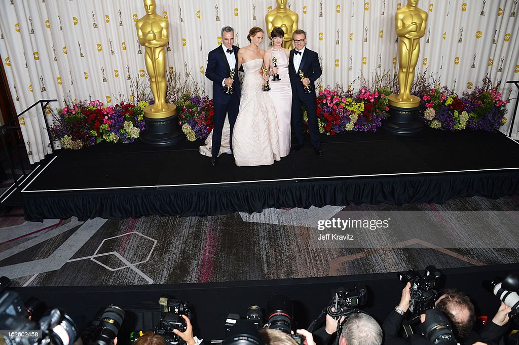 Actors Daniel Day-Lews, <a gi-track='captionPersonalityLinkClicked' href=/galleries/search?phrase=Jennifer+Lawrence&family=editorial&specificpeople=1596040 ng-click='$event.stopPropagation()'>Jennifer Lawrence</a>, <a gi-track='captionPersonalityLinkClicked' href=/galleries/search?phrase=Anne+Hathaway+-+Actress&family=editorial&specificpeople=11647173 ng-click='$event.stopPropagation()'>Anne Hathaway</a>, and <a gi-track='captionPersonalityLinkClicked' href=/galleries/search?phrase=Christoph+Waltz&family=editorial&specificpeople=4276914 ng-click='$event.stopPropagation()'>Christoph Waltz</a> pose in the press room during the Oscars at Loews Hollywood Hotel on February 24, 2013 in Hollywood, California.