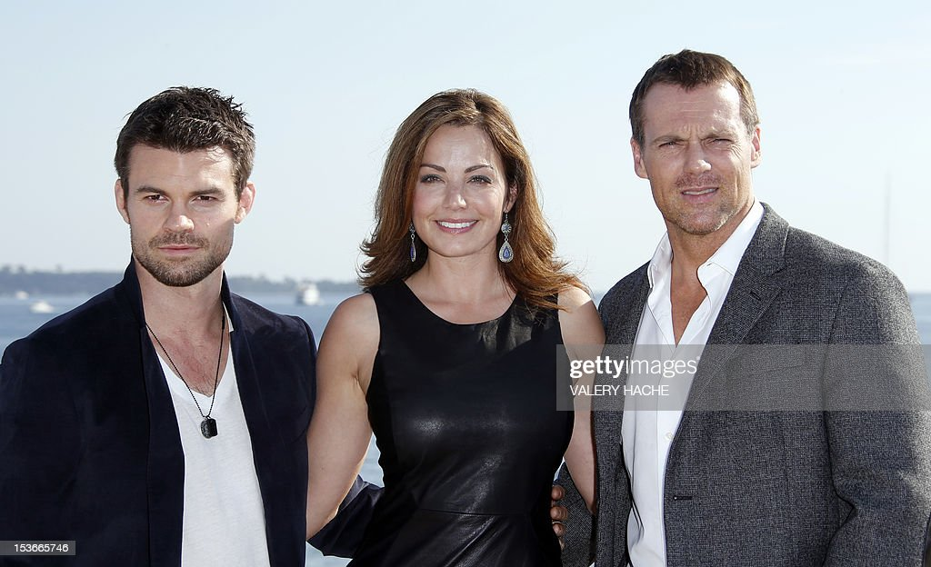 Actors Daniel Gilliies (L), Erica Durance (C) and Michael Shanks (R) pose during a photocall for the TV show 'Saving Hope' as part of the Mipcom international audiovisual trade show at the Palais des Festivals, in Cannes, southeastern France, on October 8, 2012.