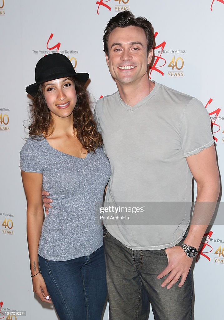 Actors Daniel Goddard (R) and <a gi-track='captionPersonalityLinkClicked' href=/galleries/search?phrase=Christel+Khalil&family=editorial&specificpeople=241522 ng-click='$event.stopPropagation()'>Christel Khalil</a> (L) attend 'The Young & The Restless' 40th anniversary cake cutting ceremony at CBS Television City on March 26, 2013 in Los Angeles, California.