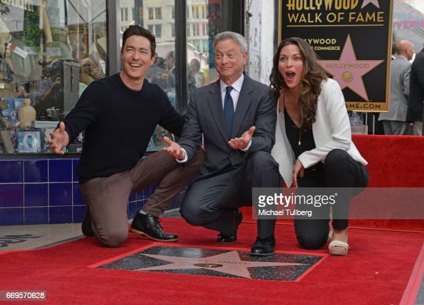 Actors Daniel Henney Gary Sinise and Alana De La Garza pose at the ceremony honoring Sinise with a star on the Hollywood Walk Of Fame on April 17...