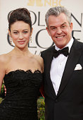 Actors Danny Huston and Olga Kurylenko arrive at the 70th Annual Golden Globe Awards held at The Beverly Hilton Hotel on January 13 2013 in Beverly...