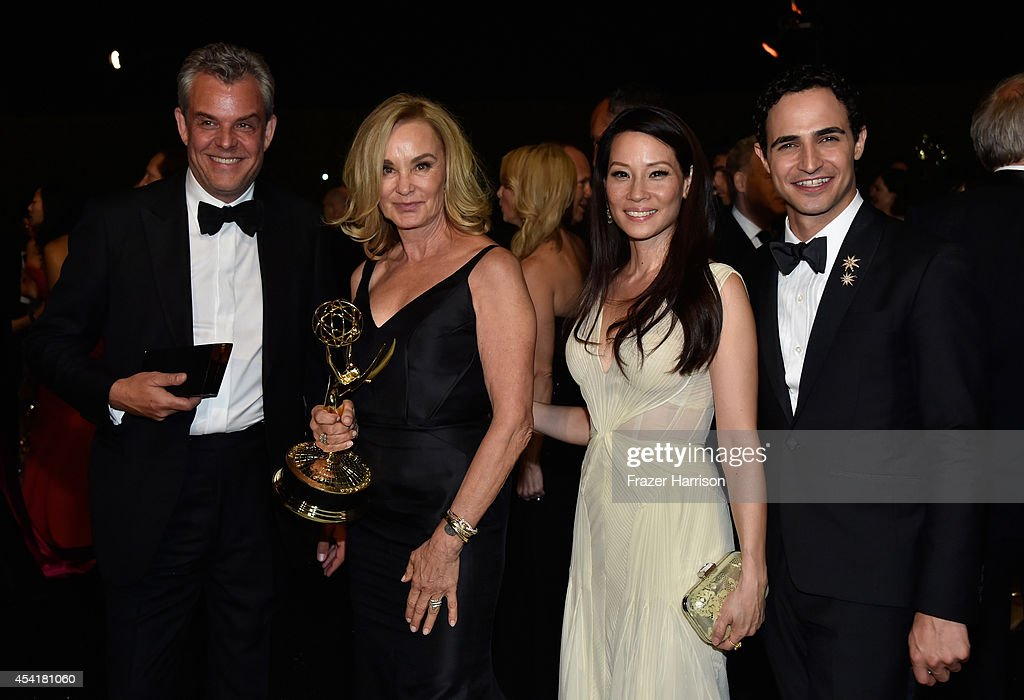 Actors Danny Huston, Jessica Lange, winner of the award for Outstanding Lead Actress in a Miniseries or a Movie, Lucy Liu and fashion designer Zac Posen attend the 66th Annual Primetime Emmy Awards Governors Ball held at Los Angeles Convention Center on August 25, 2014 in Los Angeles, California.