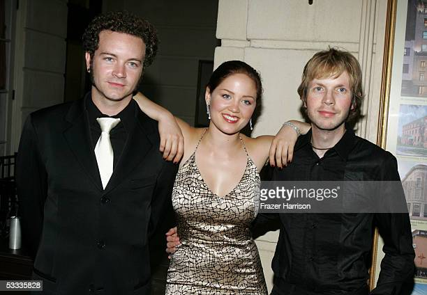 Actors Danny Masterson Erika Chistensen and musician Beck pose at the Church of Scientology Celebrity Centre 36th Anniversary Gala on August 6 2005...