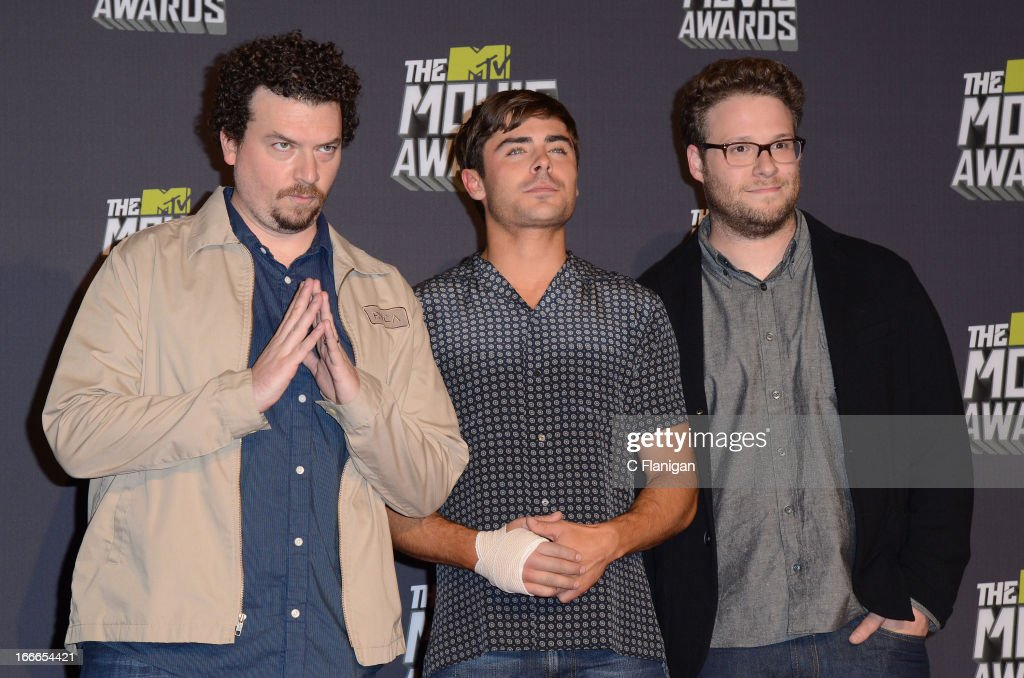 Actors Danny McBride, <a gi-track='captionPersonalityLinkClicked' href=/galleries/search?phrase=Zac+Efron&family=editorial&specificpeople=533070 ng-click='$event.stopPropagation()'>Zac Efron</a> and <a gi-track='captionPersonalityLinkClicked' href=/galleries/search?phrase=Seth+Rogen&family=editorial&specificpeople=3733304 ng-click='$event.stopPropagation()'>Seth Rogen</a> pose backstage during the 2013 MTV Movie Awards at Sony Pictures Studios on April 14, 2013 in Culver City, California.