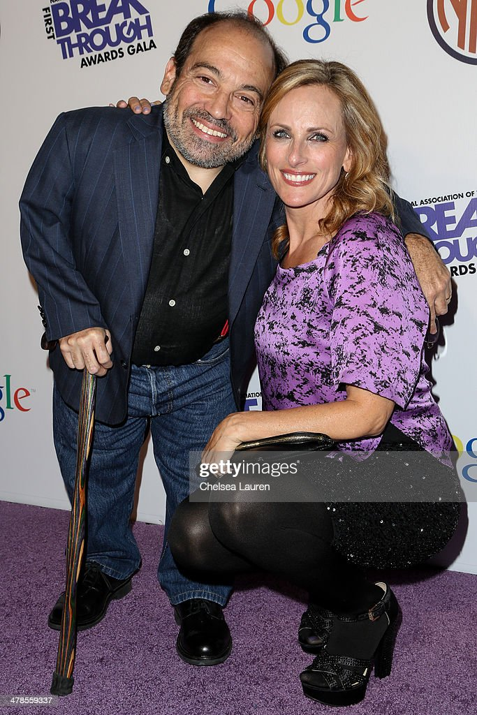 Actors Danny Woodburn (L) and <a gi-track='captionPersonalityLinkClicked' href=/galleries/search?phrase=Marlee+Matlin&family=editorial&specificpeople=173454 ng-click='$event.stopPropagation()'>Marlee Matlin</a> arrive at the National Association Of The Deaf's 1st annual Breakthrough Awards at Hollywood Roosevelt Hotel on March 13, 2014 in Hollywood, California.