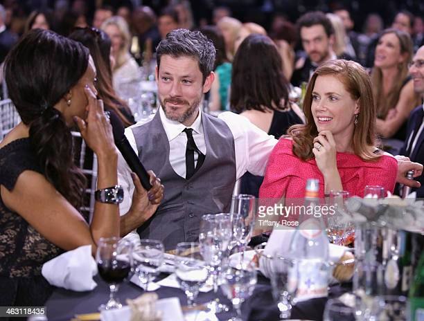 Actors Darren Le Gallo and Amy Adams and host Aisha Tyler with Champagne Nicolas Feuillatte attend the 19th Annual Critics' Choice Movie Awards at...