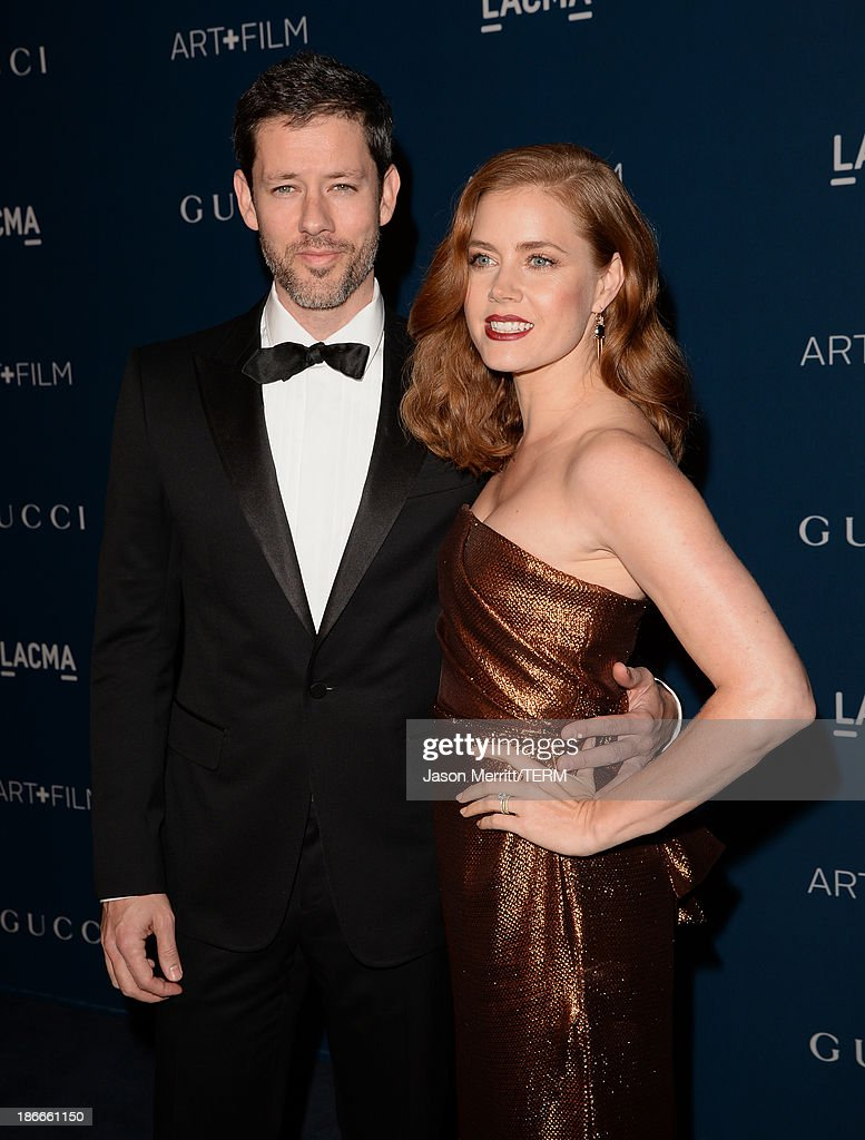 Actors Darren Le Gallo and Amy Adams, wearing Gucci, attend the LACMA 2013 Art + Film Gala honoring Martin Scorsese and David Hockney presented by Gucci at LACMA on November 2, 2013 in Los Angeles, California.