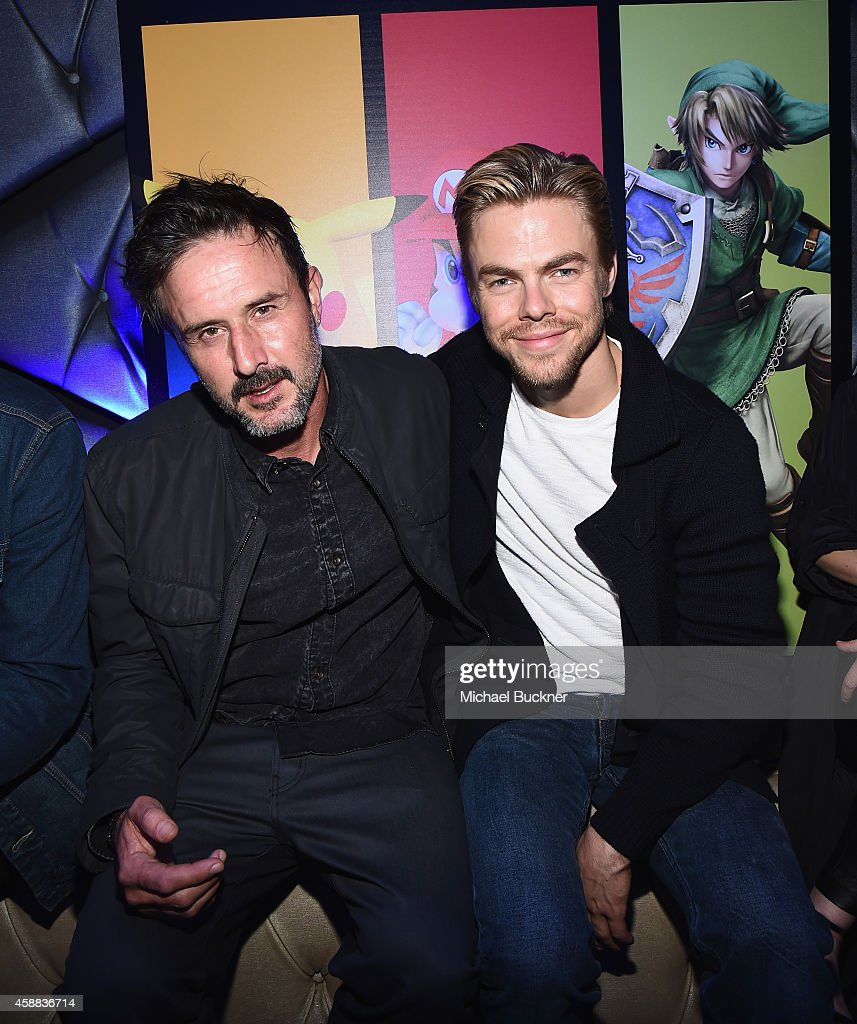 Actors David Arquette and actor Derek Hough enjoy the festivities during the Super Smash Bros for Wii U event on November 11 2014 in Los Angeles...