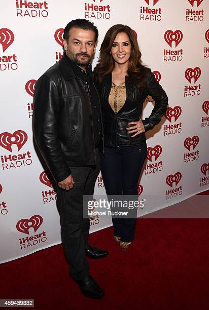 Actors David Barrera and Maria CanalsBarrera poses backstage during the iHeartRadio Fiesta Latina festival presented by Sprint at The Forum on...