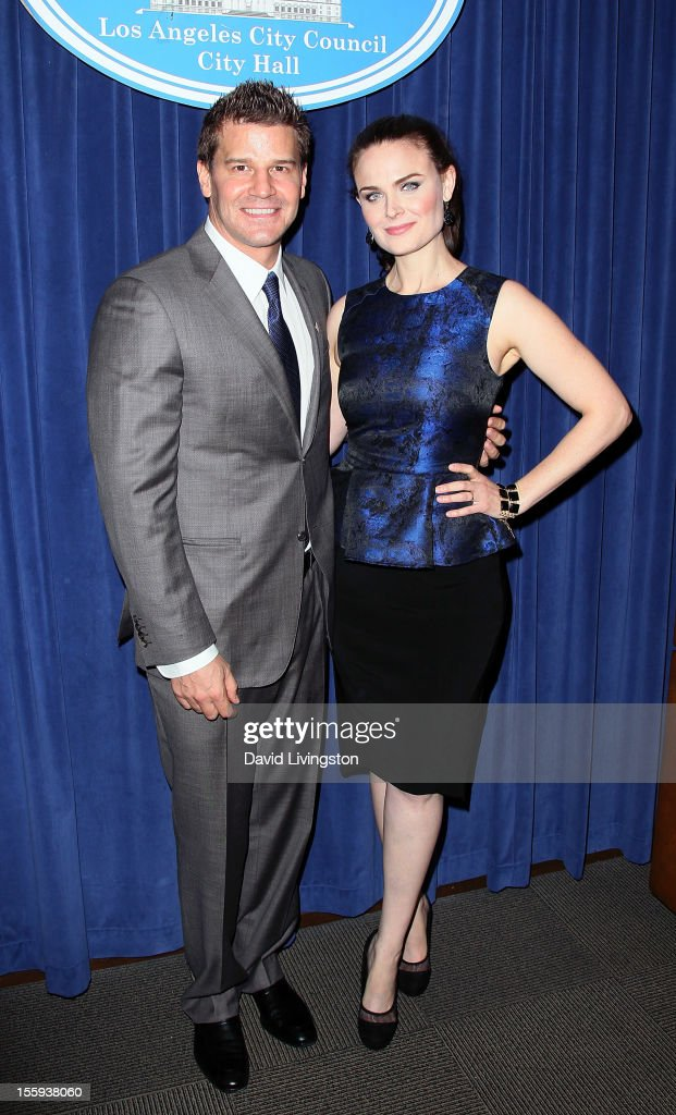 Actors David Boreanaz (L) and Emily Deschanel attend the LA City Council Chambers proclamation ceremony for Fox's 'Bones' at City Hall Council Chambers on November 9, 2012 in Los Angeles, California.
