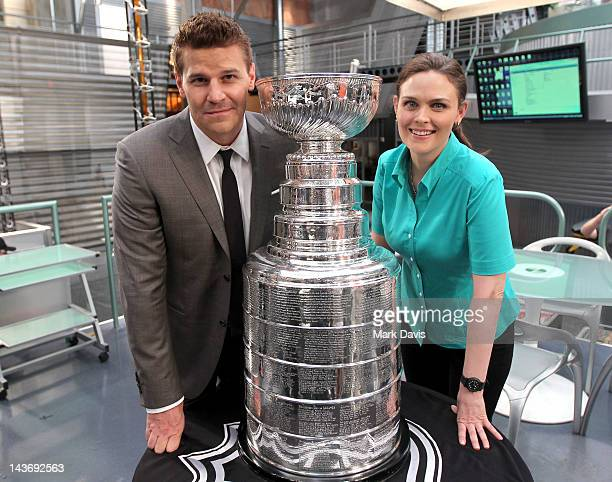 Actors David Boreanaz and Emily Deschanel pose with the National Hockey League Stanley Cup on the set of 'Bones' at the Twentieth Century Fox Studio...