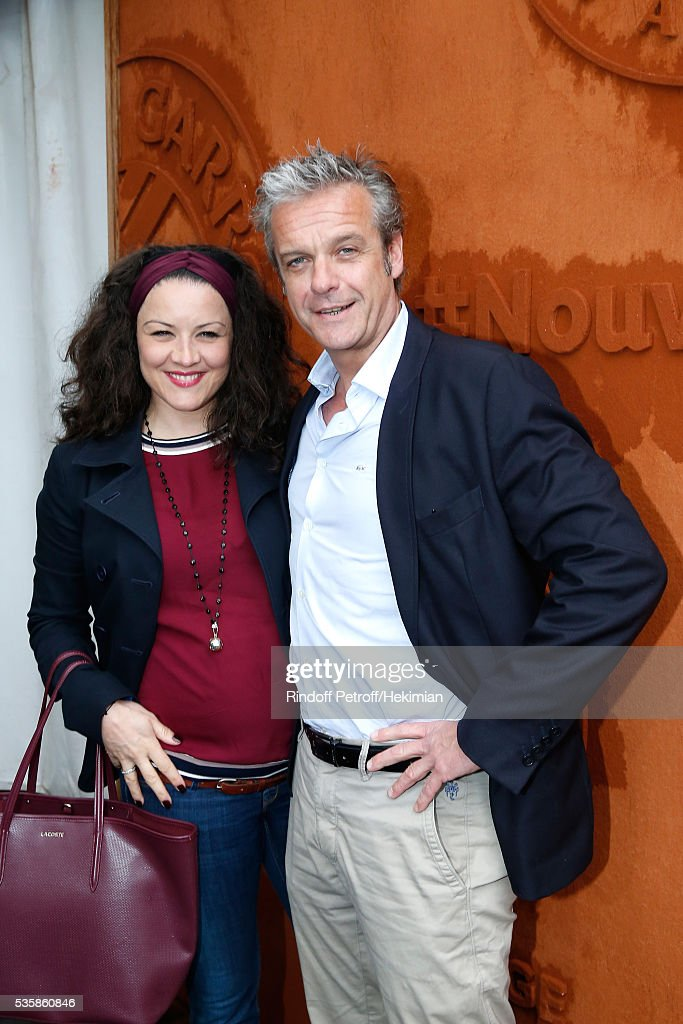 Actors David Brecourt (R) and his companion Alexandra Sarramona attend Day Nine of the 2016 French Tennis Open at Roland Garros on May 30, 2016 in Paris, France.