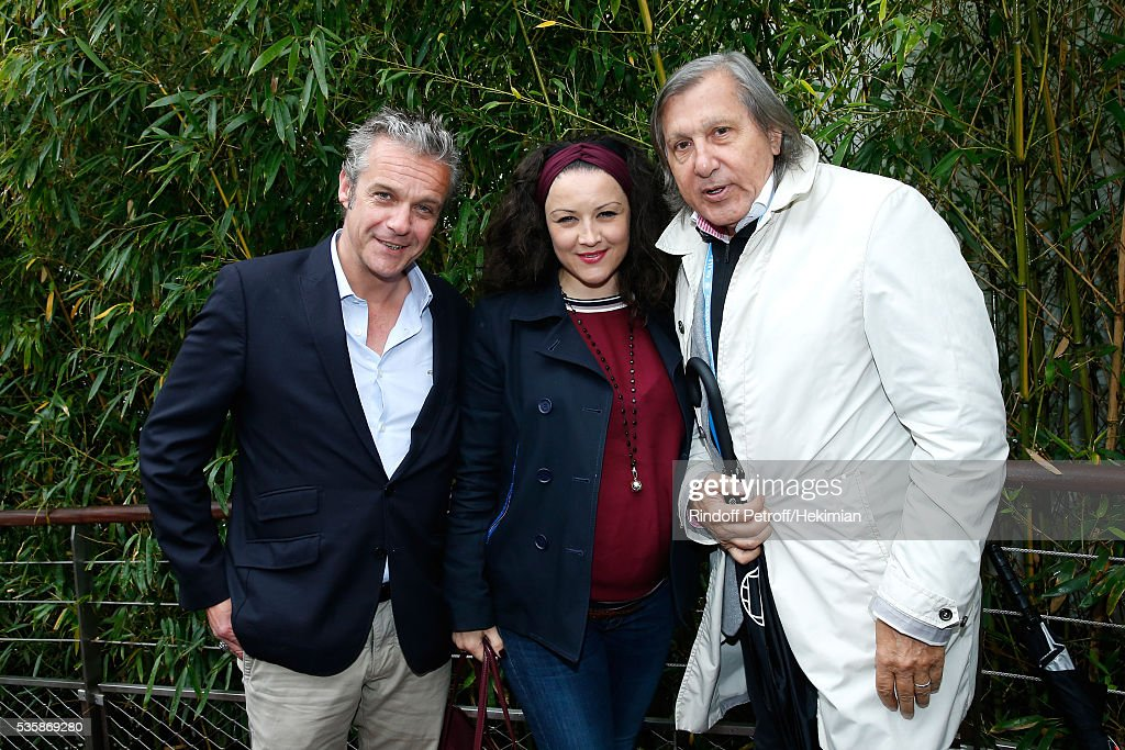 Actors David Brecourt, his companion Alexandra Sarramona and Tennis player <a gi-track='captionPersonalityLinkClicked' href=/galleries/search?phrase=Ilie+Nastase&family=editorial&specificpeople=215468 ng-click='$event.stopPropagation()'>Ilie Nastase</a> attend Day Nine of the 2016 French Tennis Open at Roland Garros on May 30, 2016 in Paris, France.