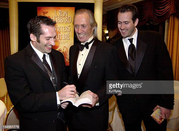 Actors David Carradine star of the soon to be released film 'Kill Bill' and Jason Lee enjoy a laugh whle seeking autographs from first place winner...