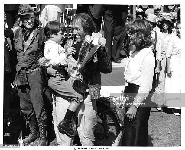 Actors David Carradine with Whit Clay and actress Brenda Vaccaro on set of the Universal Studios movie ' Fast Charlie the Moonbeam Rider' in 1979