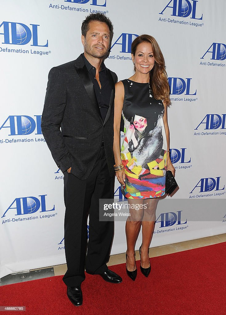 Actors <a gi-track='captionPersonalityLinkClicked' href=/galleries/search?phrase=David+Charvet&family=editorial&specificpeople=635181 ng-click='$event.stopPropagation()'>David Charvet</a> and <a gi-track='captionPersonalityLinkClicked' href=/galleries/search?phrase=Brooke+Burke&family=editorial&specificpeople=203216 ng-click='$event.stopPropagation()'>Brooke Burke</a> arrive at the Anti-Defamation League entertainment industry dinner honoring Roma Downey and Mark Burnett at The Beverly Hilton Hotel on May 8, 2014 in Beverly Hills, California.